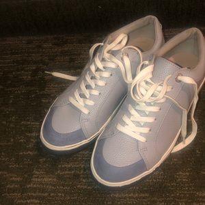 Sky blue tennis shoes